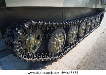 Tracks and wheels of military equipment. Exhibited on a plinth military equipment.