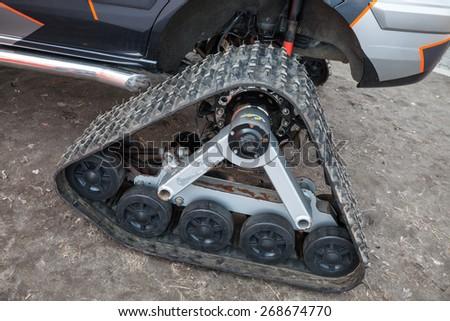 Tracks of all-terrain cross-country vehicle, closeup photo - stock photo