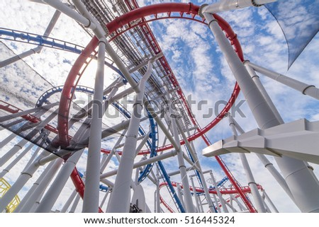 tracks of Roller coaster against blue sky, Perspective Concept.