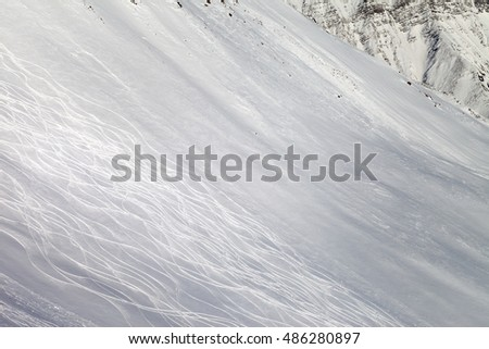 Tracks on freeriding slope. Caucasus Mountains, Georgia, region Gudauri.