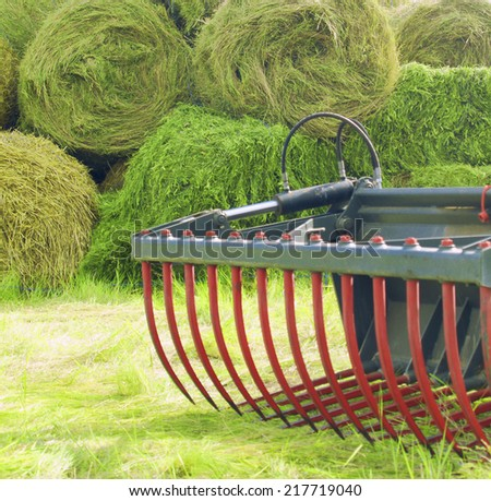 tractor and hay bales - stock photo