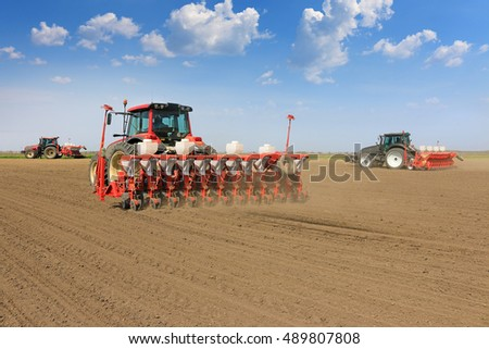 Tractor and Seeder Planting Crops on a Field