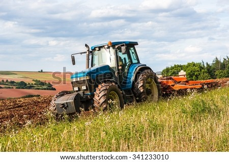 Tractor at work on a field in the Czech Republic - stock photo