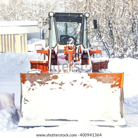 Tractor cleaning snow in winter on Kamchatka - stock photo