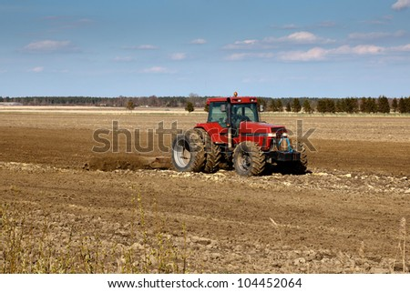 tractor cultivated fields in early spring