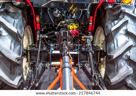 tractor engine rear view - oil machinery technology industry manufacturing wires steel tire
