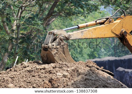 Tractor/Excavator Loader with backhoe works - stock photo