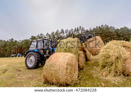 tractor hay stacks in the field. Toning