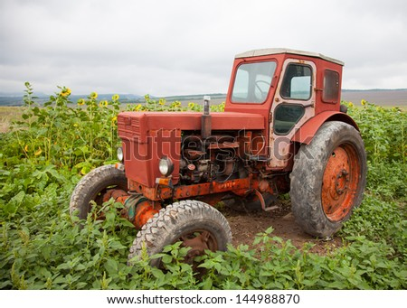 Tractor in a field - stock photo
