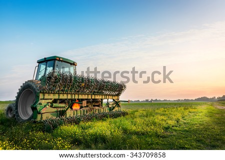 Tractor in a field on a Maryland Farm near sunset - stock photo