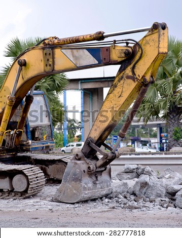 Tractor in construction site - stock photo