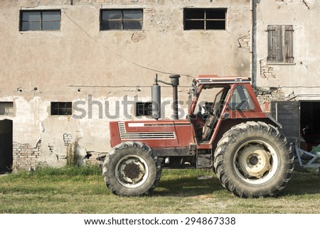 Tractor in farm - stock photo