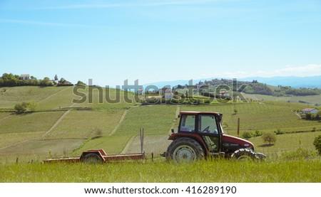 Tractor in steep vineyard - stock photo