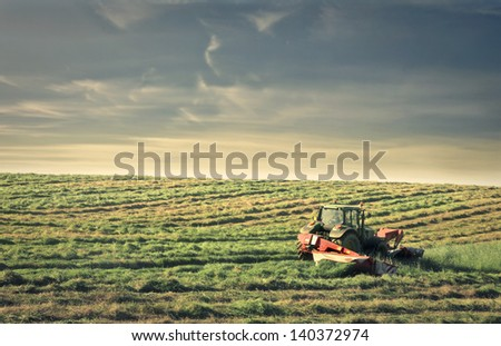 tractor in the countryside - stock photo