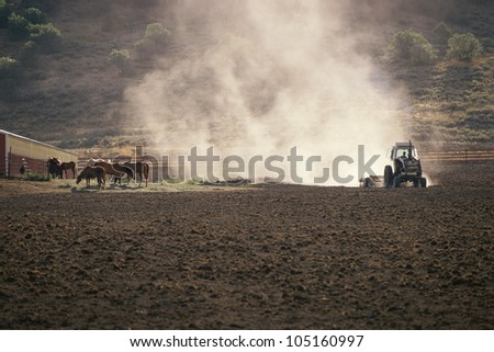 Tractor kicking up dust cloud