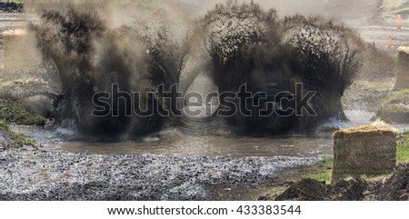Tractor mud racing - stock photo