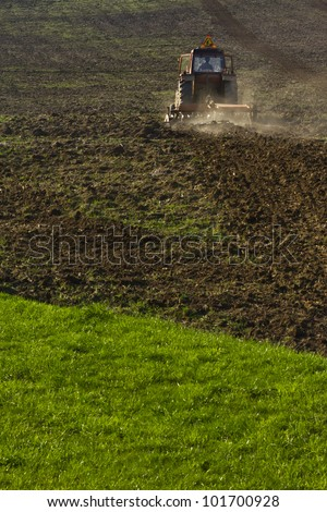 tractor on a field - stock photo