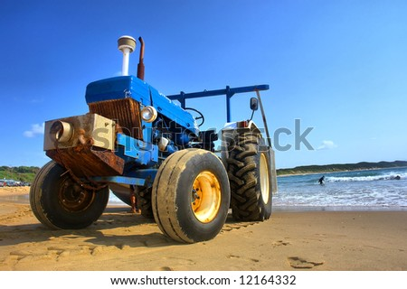 Tractor on beach. Shot in Sodwana Bay Nature Reserve, KwaZulu-Natal province, Southern Mozambique area, South Africa. - stock photo