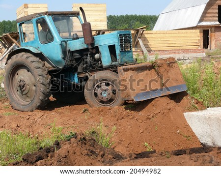 Tractor on building