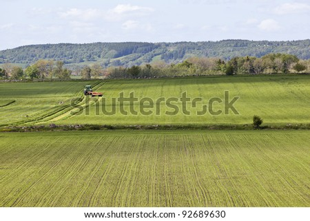 Tractor on the field for harvesting - stock photo