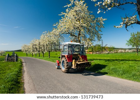 Tractor on the road in the spring country