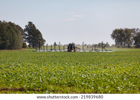 Tractor pesticide fungicide insecticide sprayer - stock photo
