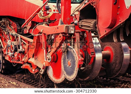 Tractor ploughing up the field.