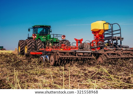 Tractor ploughing up the field.  - stock photo