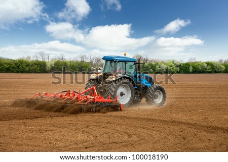 tractor plowing the fields. Agricultural landscape - stock photo
