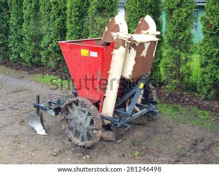 Tractor powered two furrow potato planter front view - stock photo