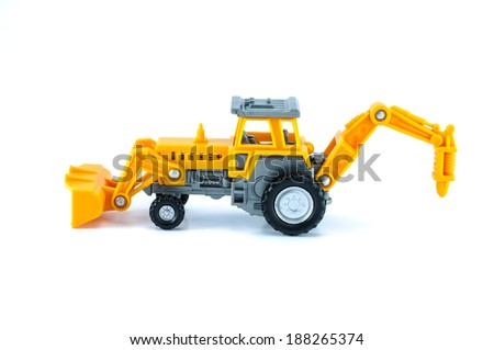 tractor toy in yellow color isolated on white