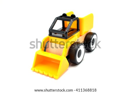 Tractor toy made from wood and plastic isolated on white background