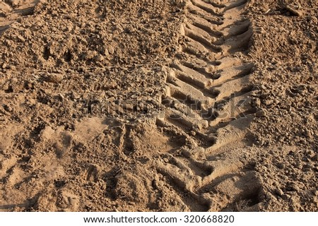 Tractor wheelmark on agricultural soil - stock photo