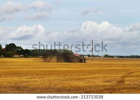 Tractor with liquid manure on the field. - stock photo
