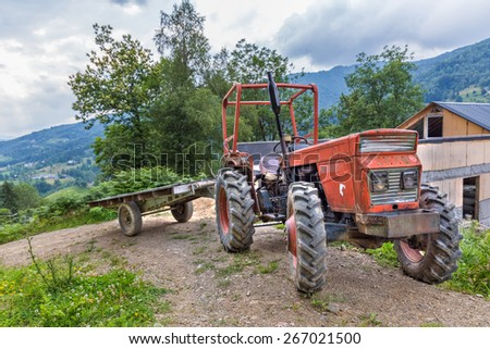 Tractor with trailer parked on a hillside in Boussenac France