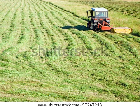 Tractor working on green grass field