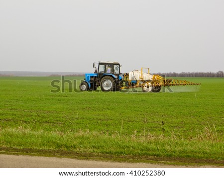 Tractors on field - stock photo
