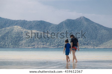 TRAD, THAILAND - APRIL 06 : Two girls walk on the Koh Chang beach on April 06, 2016.