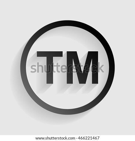 Trade mark sign. Black paper with shadow on gray background.