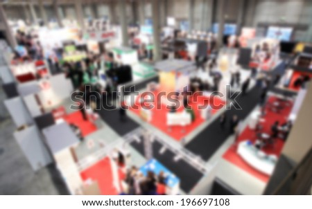 Trade show exhibition, intentionally blurred background post production - stock photo