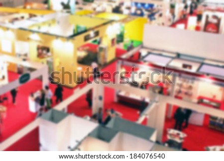 Trade show fair panoramic background, intentionally blurred post production - stock photo