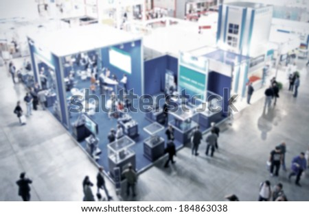 Trade show generic background, blue and intentional blurred post production - stock photo