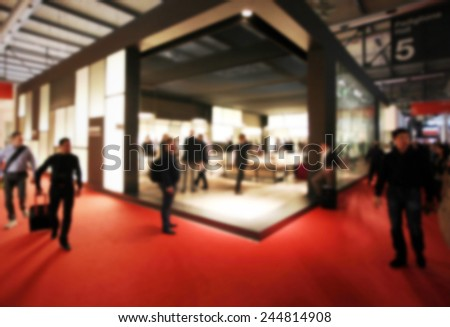 Trade show generic background. Intentionally blurred post production. Humans not recognizable. - stock photo