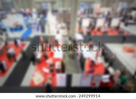 Trade show, panoramic view. Intentionally blurred post production, humans and location not recognizable. - stock photo
