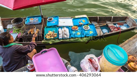 Trader's boats in a floating market in Thailand. Floating markets are one of the main cultural tourist destinations in Asia.