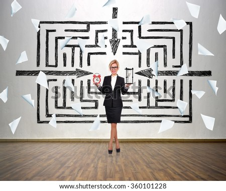 Trader woman holding sandglass and alarm clock in hand. Drawing way to success and falling blank paper. - stock photo