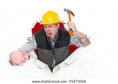 Tradesman about to smash a piggy bank - stock photo