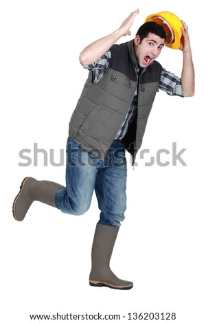 Tradesman fleeing - stock photo
