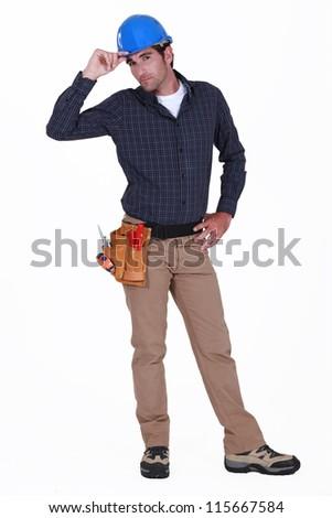 Tradesman giving a salute - stock photo