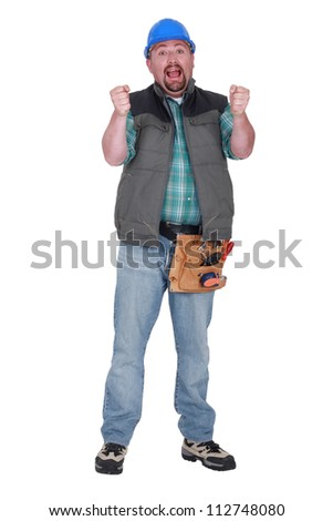 Tradesman gripping an invisible steering wheel - stock photo